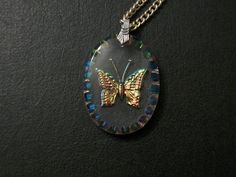 Reverse Carved Iridescent Butterfly Necklace by thedepo on Etsy,