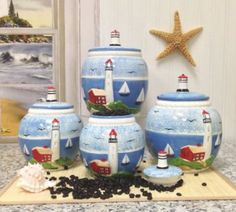 Tuscan Island Lighthouse Hand Painted 4pc Canister set 9-1/2  It is easy to find the perfect gift for lighthouse lovers when you know they love lighthouse home décor and accents that make them think of lighthouses.  Lighthouses are nostalgic, historic and adorable which is a great reason to find inspiration by this type of sea side home décor.   Lighthouse home décor can be used in any room of the home and is the perfect theme to center your home decoration around.