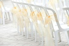 Dressing up indoor chairs. Could use any color tulle. Inexpensive. It would Also be pretty to tie them vertically
