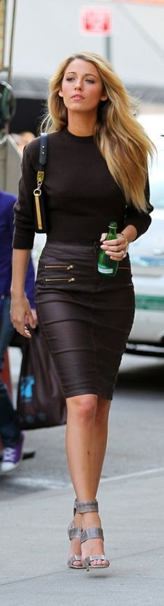 Blake Lively in all black - chic in a leather skirt with gold zippers