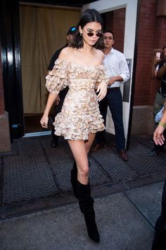 Kendall Jenner looking super girly in a mini dress and knee high boots. #ShortDressesandBoots