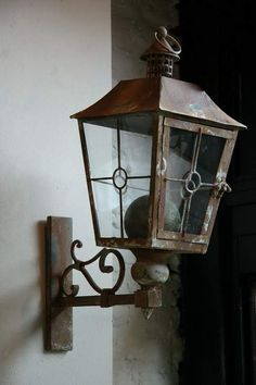 a french address for brocante - Sharon Santoni via My French Country Home blog.  lantern for front entry.