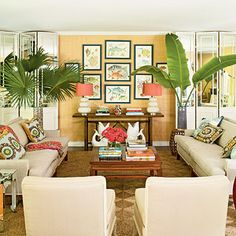 This will be the living room setup! Front door/terrace to the left side, open floor plan to kitchen on the right side, replace art display and sofa table with tv sandwiched by tropical plants!