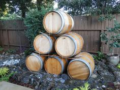 Yard Crashers: Water-Feature Wonderland Matt Blashaw drew on the homeowners' fascination with wine barrels as inspiration in creating this pyramid-shaped water feature as well other elements in the backyard design. Wine Barrel Water Feature, Water Barrel, Diy Water Feature, Yard Crashers, Barrel Fountain, Backyard Creations, Waterfall Features, Water Walls, Backyard Makeover