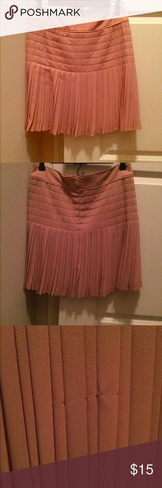J.Crew Pink Pleated Mini Skirt - Sz 2 J.Crew Pink Pleated Mini Skirt - Sz 2. Includes tags. There's a small pick in the fabric. To me, it's hard to notice with the pleats. The color is a blush pink. J. Crew Skirts Mini