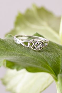 The interlacing, continuous design of the Celtic knot on this sterling silver ring is the symbol of the interconnectedness and continuity of life. Hippie Wedding Ring, Irish Wedding Rings, Unique Wedding Bands, Irish Engagement Rings, Wedding Stuff, Dream Wedding, Wedding Ideas, Celtic Knot Jewelry, Celtic Knot Ring