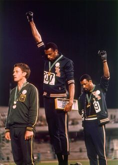 """The black power salute at the 1968 Olympics was a protest made by the African American athletes Tommie Smith and John Carlos; the athletes made the raised fist gesture at the Olympic Stadium in Mexico City. """"The Silent Gesture"""" Tommie Smith, Mexico 68, Mexico City, 1968 Olympics, Summer Olympics, Mexico Olympics, Black Power Salute, Foto Sport, American Athletes"""