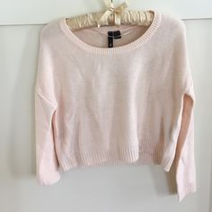 Unworn H&M Blush Cropped Sweater Size 2 Size 2 H&M Divided blush pink cropped sweater. Very faint stain on back of one sleeve although never worn. Will likely come out with care. 100% acrylic. H&M Sweaters Crew & Scoop Necks