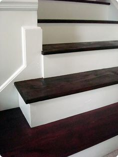 Stained wood stair treads, uprights painted. do this to our stairs when we replace carpet!