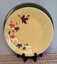 The decorated luncheon plate features autumn leaves (in Fiesta® colors Sage Poppy Sunflower and Claret) on an Ivory plate. Both plates ... & Fiesta® Autumn Leaves Luncheon Plate paired with Claret Fiesta ...