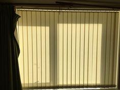 Vertical blinds, Llangollen.  http://blindsllangollen.co.uk  Note the curtain pole!!