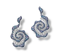 CARNET. A pair of paraiba tourmaline, coloured sapphire and diamond 'Sparkling Swirl' earrings.