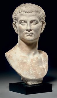A Roman marble portrait bust of a man Julio-Claudian period, circa 1st century A.D.  Depicting a man of middle age, with his head turned to his right, the expressive face with a broad cranium, thick modelled brows, unarticulated lidded eyes, a slender nose rounded at its tip, the small mouth with a full upper lip, and a rounded chin, with short wavy hair