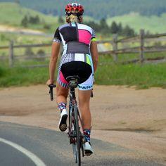 Woman riding bike wearing Panache Mondrian Cycling Jersey and Bib Shorts