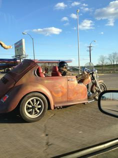 This man took the back of a old Volkswagen bug and put it in the back of his motorcycle, the badassery is just too much!
