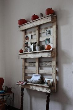 Amazing Uses For Old Pallets – love the photo/shelf. could also use other side if just wanting to display photos. pin with wooden pins under creative board.