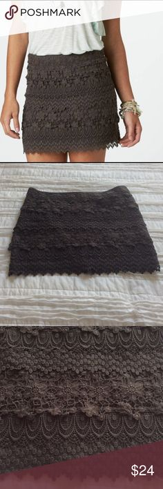 "American Eagle Outfitters Tiered Lace Miniskirt New American Eagle chocolate tiered lace miniskirt. Length is 15"". 80% cotton and 20% polyester. NWOT American Eagle Outfitters Skirts Mini"