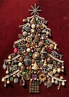 """Large (21""""x 17"""") Christmas tree made from old costume jewelry."""