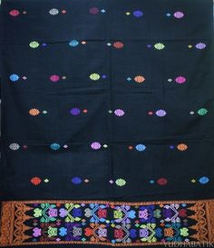 "The whole view (jembrengan) of Songket Jembrana. The head section of the songket is decorated with ""tunjung"" pattern in multicolor thread, while the bodice decorated with ""bulan bintang"" (moon and star) pattern. From Jembrana, West Bali"