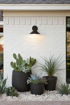 Beautiful display for front or back yard! Succulents in pots paired with painted bricks #greendreams #succulents #pots