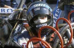 Jacques Laffite in his Ligier Talbot Matra with his helmet on during ...