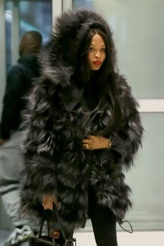 Naomi Campbell #NaomiCampbell Keeps Warm in a Large Fur Coat  JFK AIrport in NY 11/03/2017 Celebstills N Naomi Campbell