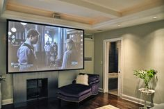 motorized screen in front of fireplace