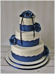 Navy Blue wedding cake with scalloped and pearl trim and edible blue roses  Keywords: #navyblueweddings #jevelweddingplanning Follow Us: www.jevelweddingplanning.com  www.facebook.com/jevelweddingplanning/