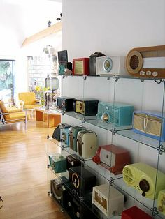 retro radios. I TOTALLY want a wall display just like it!
