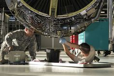 Staff Sgt. Brian Fielhauer and Senior Airman Otto Kelly service the engine of a KC-135 Stratotanker as part of the isochronal inspection process of the aircraft Sept. 14, 2013, at Selfridge Air National Guard Base, Mich. Kelly is a member of the 191st Maintenance Squadron at Selfridge ANGB. During the process, all components of the aircraft undergo an extensive inspection and preventive maintenance. (U.S. Air National Guard photo/Tech. Sgt. Robert Hanet)