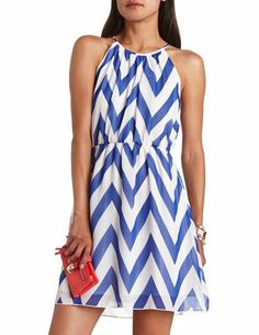 The chevron dress is a simple yet sophisticated way to impress your date. The clutch has a pop of color to add to the outfit and carry all your small essentials.