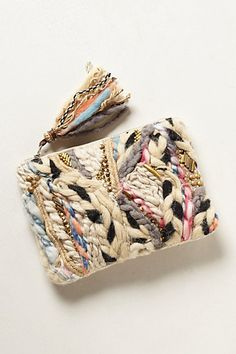 Anthropologie: Beige Woven Tapestry Pouch. Zip closure. Cotton, wool, metal.