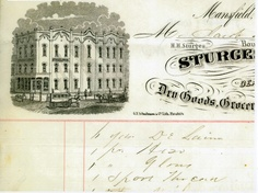 This is a close-up scan of the artwork on an invoice issued by the Sturges and Wood, Dry Goods, Groceries, etc. The store was located at the corner of North Main and North Park Street. The building, which also held the Whissemore photographic studio, later became the H. L. Reed Company and, after that, Ed Pickens' Cafe on Main.