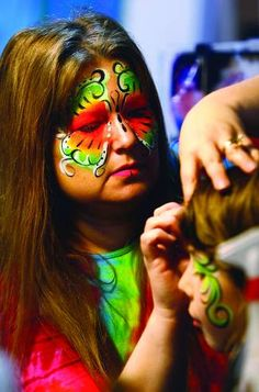 ROBIN LOZNAK/The News-Review  Face painter Ruth Ann Roundtree works at  the 33rd annual Spring Fair last year at the Douglas County Fairground. Spring Fair, Douglas County, Painted Faces, Face And Body, Body Painting, Robin, Ann, News, Bodypainting