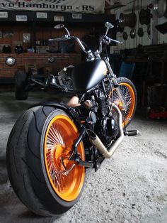 #harley orange rims custom #bobber