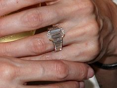 Angelina Jolie's unique engagement ring -- emerald cut with baguettes!  #engagement #engagementrings #jewelry #uniqueengagementrings #weddings  #celebrity #angelinajolie