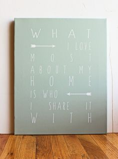 """What I love most about my home is who I share it with"" Sketchy black font on a white background. Available as an unframed print or on canvas. Various sizes available. FINE ART PAPER •Professionally p"