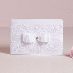 The Beverly Clark French Lace Guestbook is an elegant piece withdelicate lace embellishments and satin bow. This Guest Book is a perfect accessory for any whimsy wedding. Pair with the matching Penholder (sold separately) to complete the look.