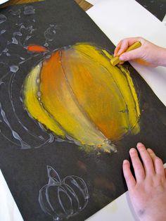 Pamela Holderman  make a glue outline of a pumpkin on black, let glue dry, color in with pastels