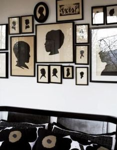 Black silhouettes in different forms and scales creates an interesting and intriguing wall of art.
