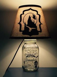 Beautifully hand crafted mason jar lamp inspired by Alice in Wonderland. This listing includes the base, lighting fixture, and shade (silhouette