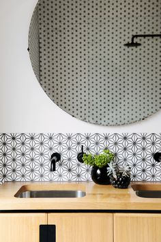 geometric tile backsplash | black faucets | black shower head | wood vanity | wood countertop | wood & black | round mirror | Parkview Ave, Brunswick - HEARTH