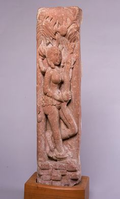 2nd C. Shalabhanjika -a voluptuous female holding onto tree is an ancient Indian motif. She decorates a pillar that was once part of a circular railing used to create a sacred space around a monument; either Hindu, Jain or buddhist. Kushan Empire, Mathura.Uttar Pradesh, India.