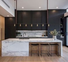 marble, black cabinetry