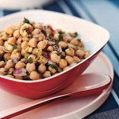 Lemony Chickpea Salad | Serve F&W Best New Chef 1991 Tom Colicchio's fresh-tasting chickpea salad with warm, soft pita bread to soak up the olive oil dressing.