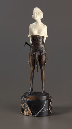AN AUSTRIAN PATINATED BRONZE AND IVORY FIGURE: YOUNG WOMAN WITH CANE After Bruno Zach (Austrian, 1891-1935), circa 1920