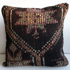 Sukan / Handwoven Goat Hair Wool Vintage Tribal Turkish Kilim Pillow Cover - 16x16 inch. $29.95, via Etsy.