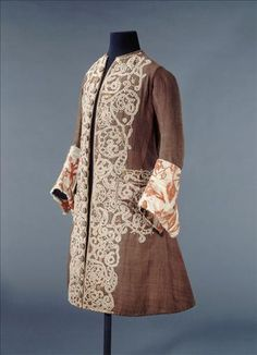 Between 1700-1725  Description Twill wool coat. Lace application. Sleeve cuffs, white satin. Embroidery, chenille red silk