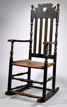 Skinner's - The Personal Collection of Lewis Scranton, Auction 2897M. May 21, 2016. Lot: 299. Estimate: $2,000-4,000. Realized: $2,600. Description: Black-painted Heart and Crown Armchair, Stratford, Connecticut, 18th century, pierced cresting over molded bannisters with vase and ring turnings, carved arms terminating in carved hands, and early splint seat with early added rockers, old paint, ht. 47 in. Provenance: Howard Richmond, 1972.