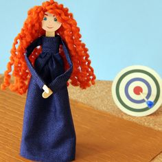 Here's how you and your child can transform a swatch of fabric and some bright bulky yarn into a doll that resembles the adventurous young archer.